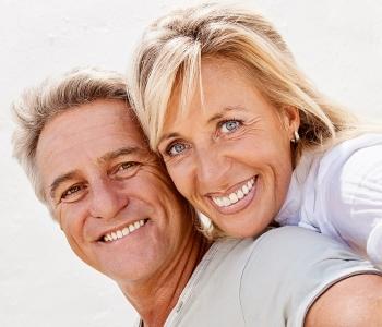Senior couple smiling with beautiful teeth