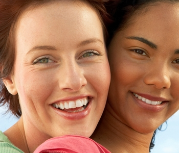 Middle aged woman and older woman with beautiful teeth