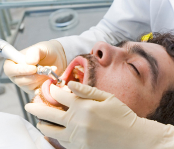 Patient getting teeth cleaning