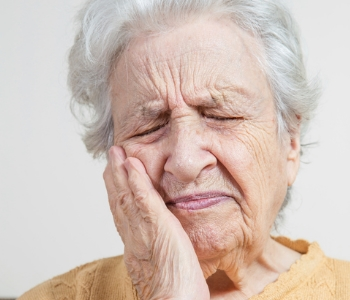 Senior woman in tooth pain