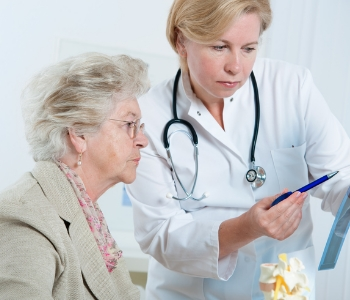 Senior woman consult with dentist