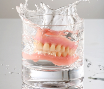 Dentures in glass filed with water