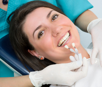Smiling woman lying in a dental chair