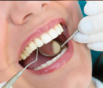 A Dentist checking patient teeth