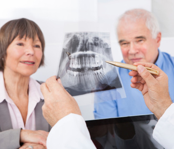 Dentist checking an x ray with the patient