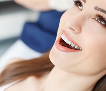 Dentist examining mouth