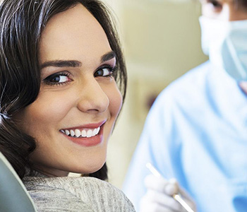 Female dentist checking patient's teeth