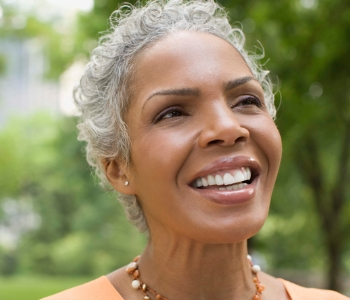 Elderly woman smiling with perfect teeth