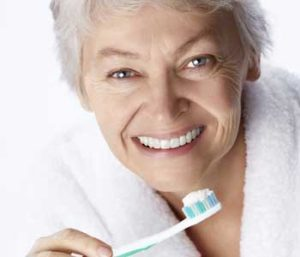 Senior woman holding a toothbrush