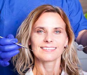 Happy smiling mature woman at dentist