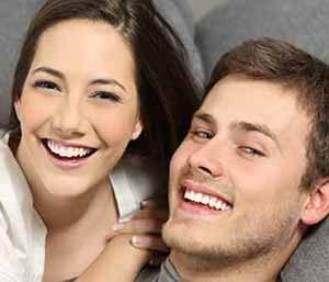 Young couple smilling, with showing their whiter teeth