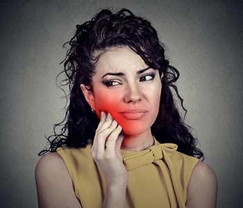 Woman suffering from gum disease